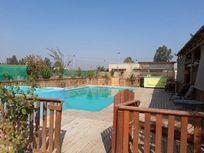 Parcela de 5300 metros  con 4 casas y 2 piscinas.