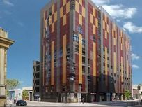 Venta oficina nueva centro Temuco con estacionamiento