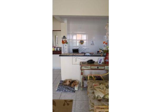 apartamento 2 dormitórios com suite e sacada em vila caiçara praia grande