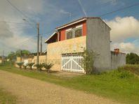 Casa com 3 dormitórios à venda, 130 m² por R$ 220.000 - Balneário Claudia Mara - Ilha Comprida/SP